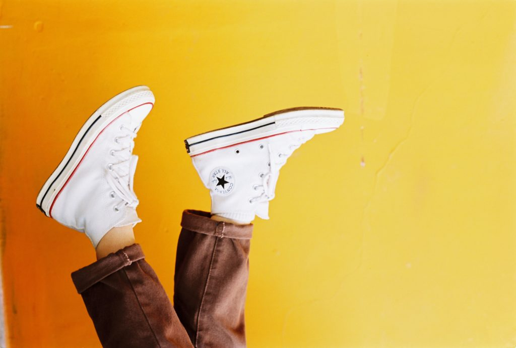 photo-of-person-wearing-converse-all-star-sneakers-2421374