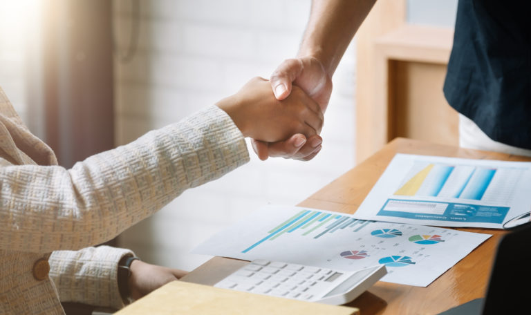 business people handshake for teamwork of business merger and ac
